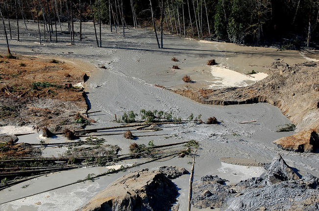 A view of the breach where water from the Stillaguamish River is beginning to move through the dam created by Saturday's mudslide on SR 530 in Oso.