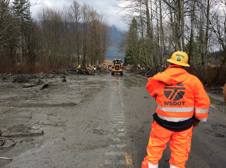 WSDOT maintenance crews helping clear a path on SR 530 for emergency response to the landslide in Snohomish County.