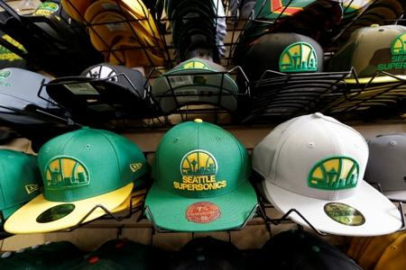 Stacks of Seattle SuperSonics caps sit in a shop near where a proposed NBA/NHL arena is set to be built.