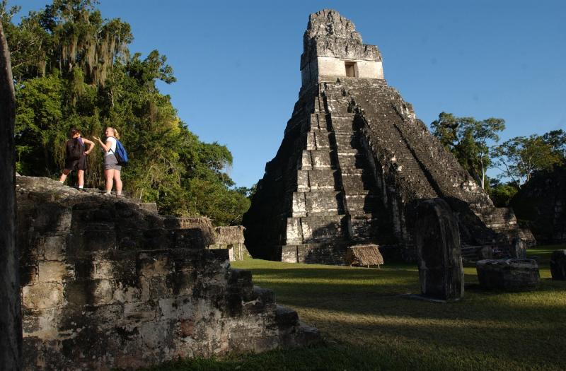 Tourists are seen at the Mayan ruins of Tikal, in Guatemala, in 2005. Nearly two decades after war, Guatemala is earning new fame as a top tourist destination.