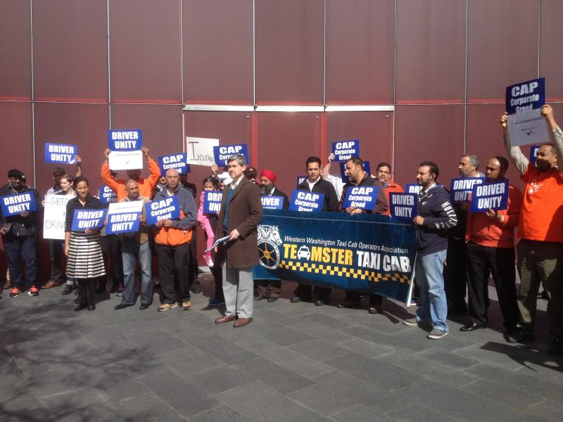 Taxi drivers gathered outside City Hall Monday, calling for a level playing field.
