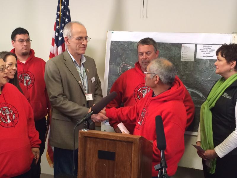 Chuck Morrison, left, of the Red Cross accepts a check for $50,000 from Snoqualmie Tribe vice chair Bob De Los Angeles.