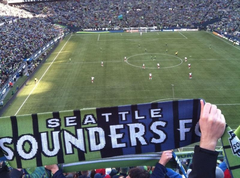 A Sounders fan holds up a scarf as the Seattle soccer club takes on the Portland Timbers in 2013.