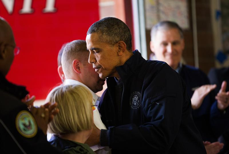 President Barack Obama, right, hugs Oso Fire Chief Willy Harper after making his remarks to the media and an audience of first responders inside the Oso Fire Department after surveying the damage and response efforts on Tuesday, April 22, 2014.