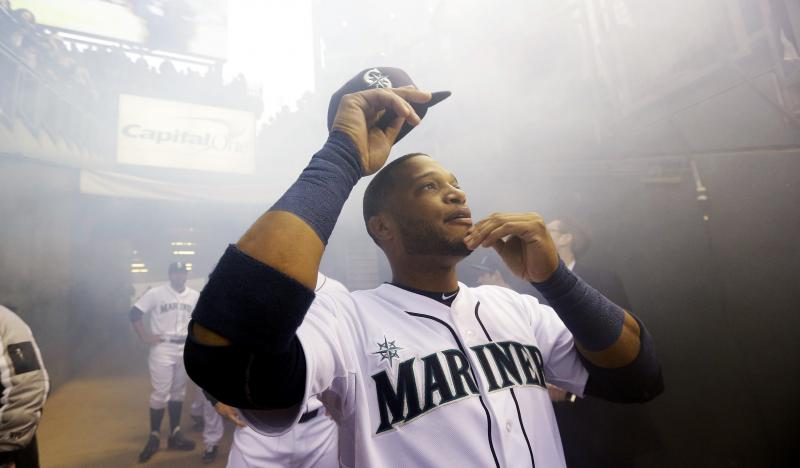 Seattle Mariners' Robinson Cano looks up as he prepares to run onto the field for player introductions before the Mariners' baseball home-opener against the Los Angeles Angels, Tuesday, April 8, 2014, in Seattle.