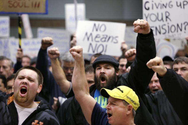 Machinists union members and supporters chant at a rally asking members to vote against a proposed contract Thursday, Jan. 2, 2014, in Seattle.