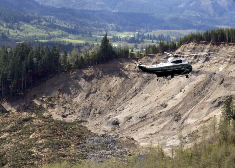 Marine One helicopter, carrying President Barack Obama, takes an aerial tour of Oso, Wash., Tuesday, April 22, 2014, above the site of the deadly mudslide that struck the community in March.