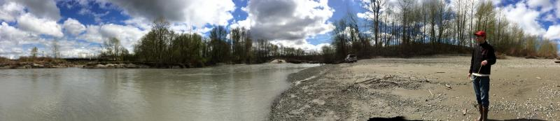 Jason Griffith, fisheries biologist with the Stillaguamish Tribe, stands on the bank of the river below the slide.