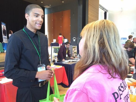 "Nigel Wea, 22, speaks with one of the 80 prospective employers at Tuesday's ""Jobfest,"" a job fair in Tacoma for 16 to 24 year olds."