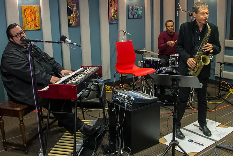 Left to right: Joey DeFrancesco, Gene Lake and David Sanborn performing live in the KPLU studios.