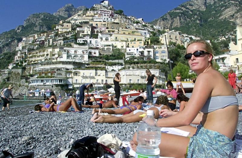 Positano, on the Amalfi coast, offers beaches and small village life you won't find in crowded Rome, Florence and Venice.