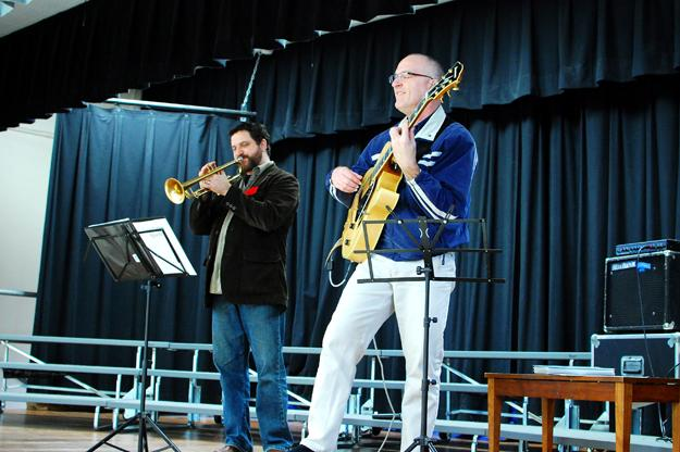 Jason Parker, left, performs for students at Addison Elementary School in Palo Alto, California.