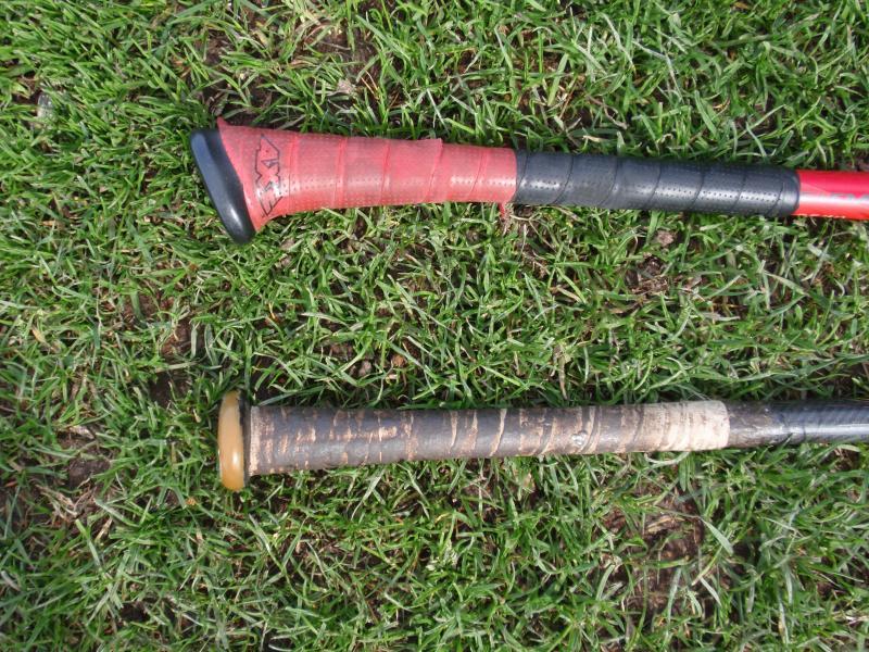Axe Bat on top versus traditional bat at bottom.