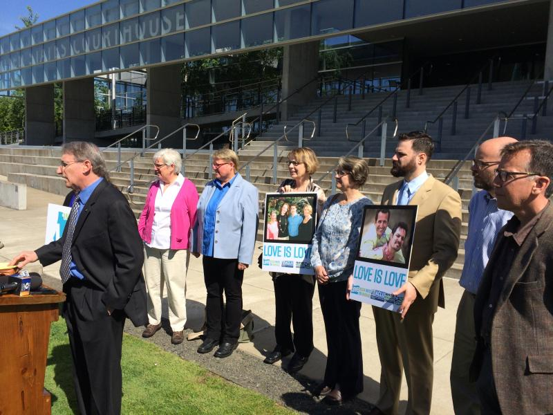 Plaintiffs gathered outside the courthouse to celebrate the denial of the motion to intervene.