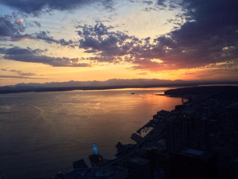 The sun sets over the Seattle waterfront on Thursday, May 15, 2014.