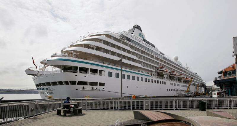 FILE - A cruise ship sits moored at a pier in downtown Seattle Friday, April 15, 2011.
