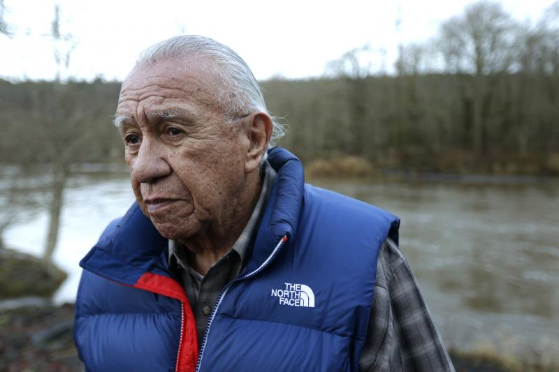 Billy Frank Jr., a Nisqually tribal elder who was arrested dozens of times while trying to assert his native fishing rights during the Fish Wars of the 1960s and '70s, poses for a photo Monday, Jan. 13, 2014, near Frank's Landing on the Nisqually River in