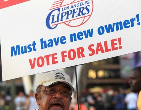 Sam Wright protests against Los Angeles Clippers owner Donald Sterling, outside Staples Center before Game 5 of the Clippers' opening-round playoff series against the Golden State Warriors on Tuesday, April 29, 2014, in Los Angeles.