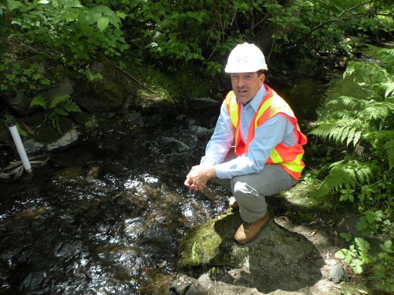 SPU's Jason Sharpley survey's a culvert that will soon be removed to help restore Thornton Creek.