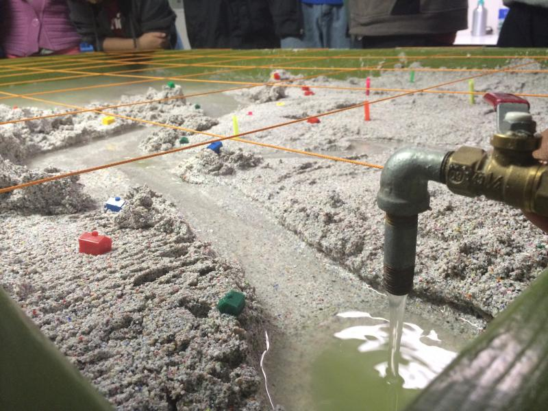 The sand table in NatureBridge's classroom building uses pumps and several water spouts to model how rivers flow and erode soil.