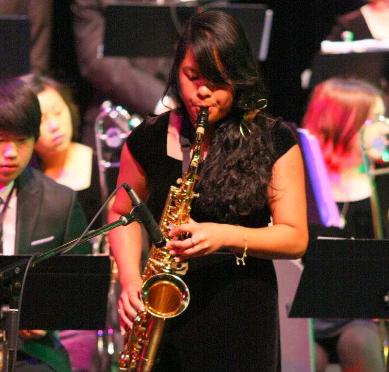 Monique Khim performs on stage.