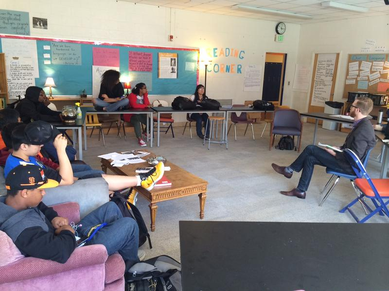 "Teacher Colin Pierce speaks with students in his International Baccalaureate ""Theory of Knowledge"" class at Rainier Beach High School."