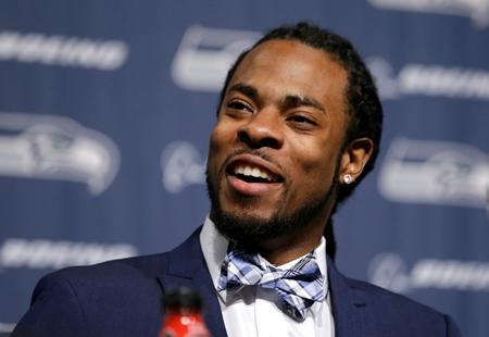 Richard Sherman addresses a news conference at the team's headquarters in Renton. Sherman signed a four-year contract extension Wednesday, making him the highest-paid cornerback in the NFL.