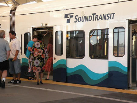 Passengers get off a Sound Transit light rail train.