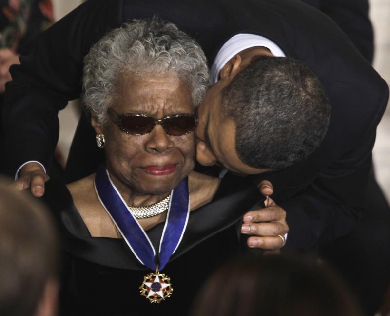 President Barack Obama kisses author and poet Maya Angelou after awarding her the Medal of Freedom during a ceremony in the East Room of the White House in Washington, D.C., in 2011.