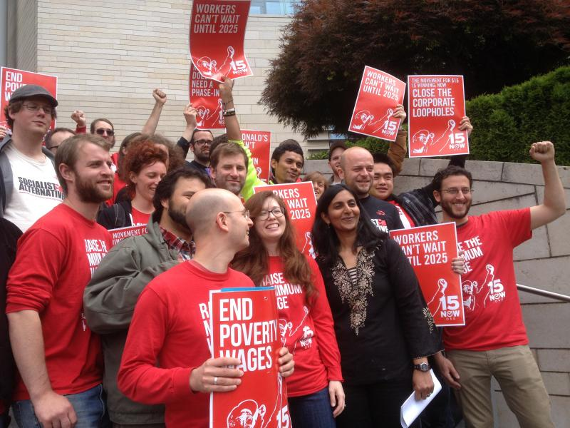 Kshama Sawant and members of 15 Now cheer the vote by the city council committee to approve raising the minimum wage.