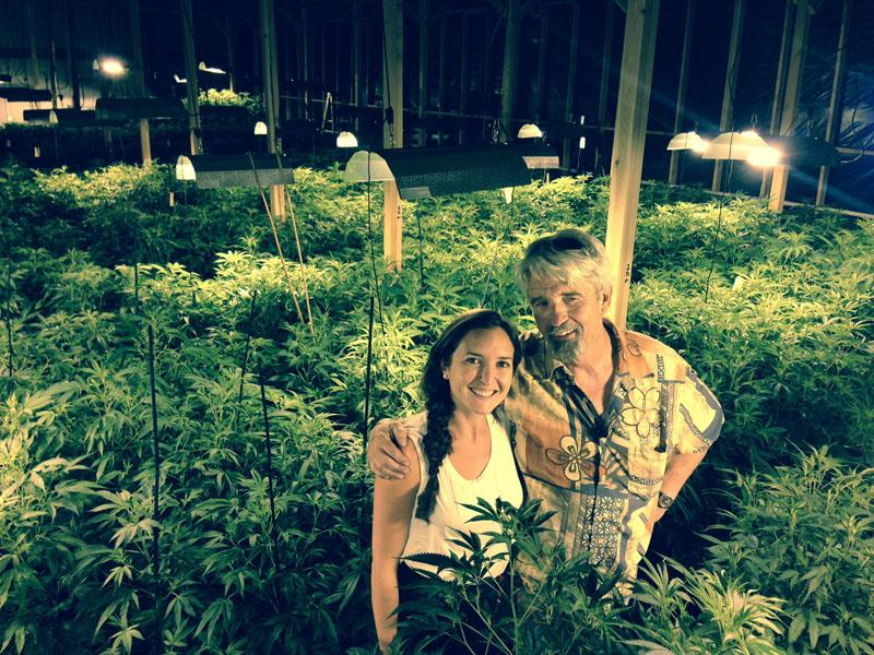 Eric and Katey Cooper stand amid their flowering marijuana.