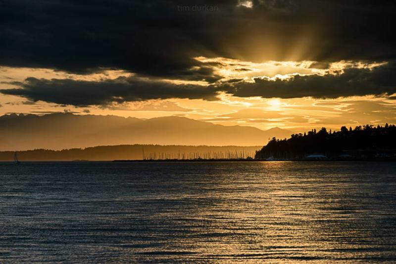 The sun sets over Puget Sound on June 10, 2014.