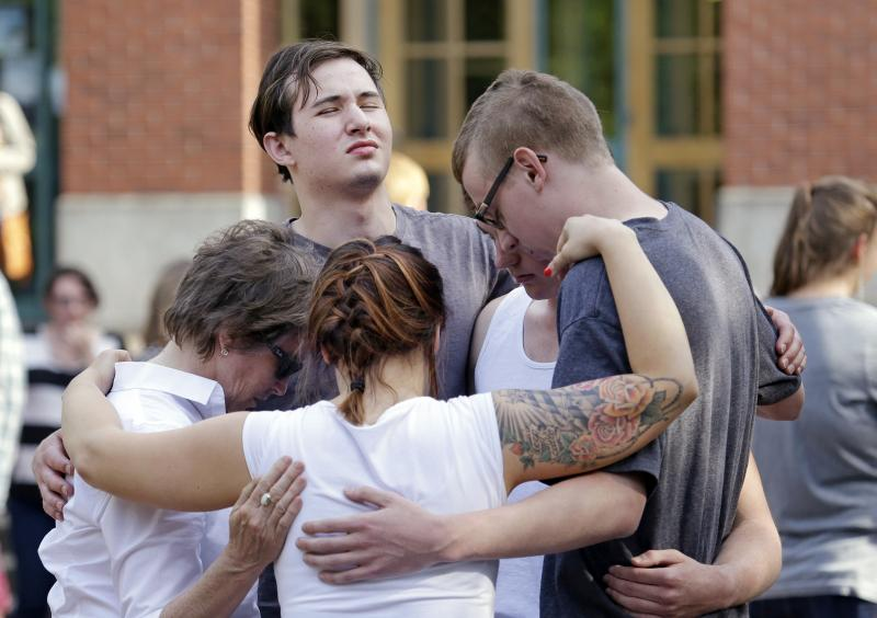 Students and faculty pray together following a shooting on the campus of Seattle Pacific University Thursday, June 5, 2014, in Seattle.