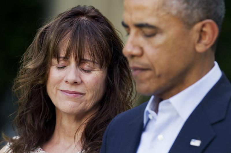 Jani Bergdahl, mother of U.S. Army Sgt. Bowe Bergdahl, reacts as President Barack Obama speaks about the release of her son, during a news conference in the Rose Garden of the White House in Washington on Saturday, May 31, 2014.