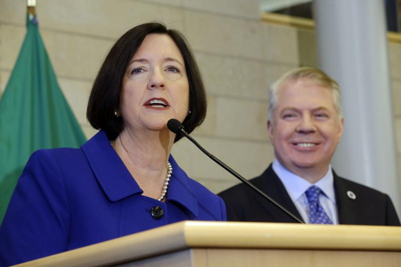 FILE - Former Boston police commissioner Kathleen O'Toole left, speaks after being introduced by Seattle Mayor Ed Murray, right, as his nominee to be Seattle's new Chief of Police, Monday, May 19, 2014, in Seattle.