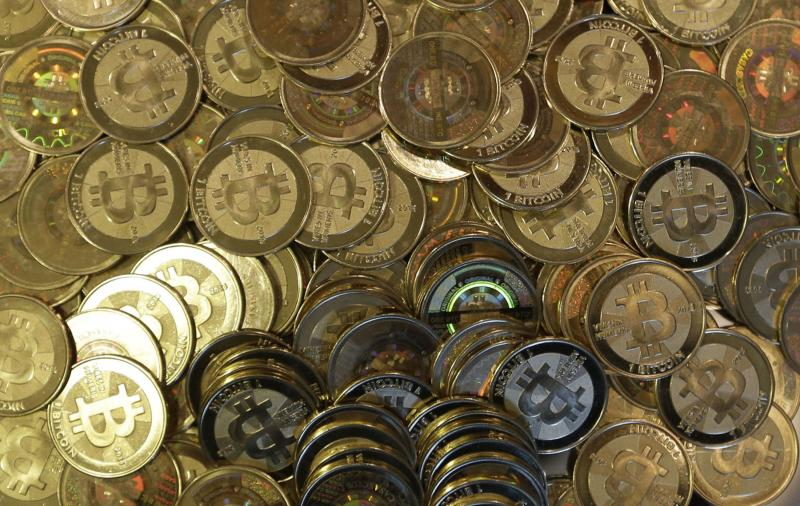 FILE - This April 3, 2013 file photo shows bitcoin tokens in Sandy, Utah.