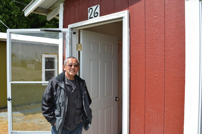 Steve Sakuma in front of newly renovated worker cabins at Sakuma Brothers Farms