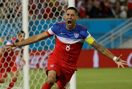 USMNT captain and Sounders star Clint Dempsey celebrates after scoring the opening goal in the first 30 seconds of play during the group G World Cup soccer match between Ghana and the U.S.  in Natal, Brazil, Monday. The U.S. won the match 2-1.