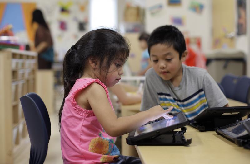 Pre-K students use electronic tablets in San Antonio, another city that has made a city-wide early childhood education push.