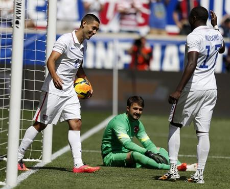 Sounders star and USMNT captain Clint Dempsey, left, celebrates with teammate Jozy Altidore, right, after scoring a goal against Turkey  during a pre-World Cup friendly, Sunday, June 1, in Harrison, N.J. The U.S. won 2-1.