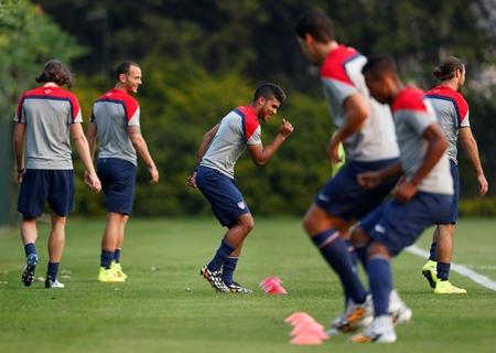 DeAndre Yedlin, center, works out with teammates during a training session in Sao Paulo, Brazil, Tuesday, June 17, 2014.