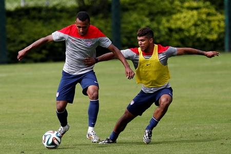 United States' Julian Green, left, and DeAndre Yedlin compete for the ball during a training session at the Sao Paulo FC training center in Sao Paulo, Brazil, Wednesday, June 11, 2014.