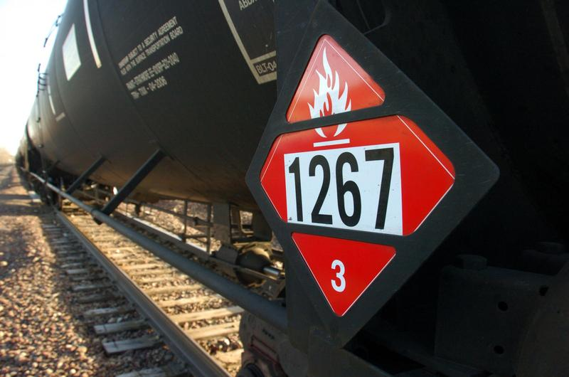FILE - In this Nov. 6, 2013 file photo is a warning placard on a tank car carrying crude oil near a loading terminal in Trenton, N.D. U.S.