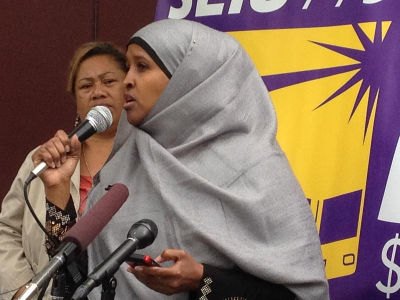 Ubah Aden, a home care worker in Seattle, at a rally calling for a new state contract that phases in a $15/hour minimum wage for independent home care workers