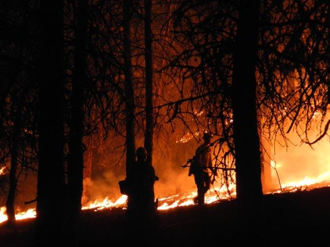 This file photo shows fire crews working the Trinity Ridge Fire near Featherville, Idaho in 2012.