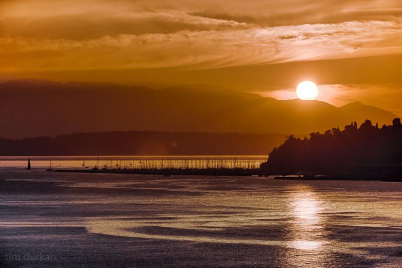 The summer sun sets over Elliott Bay.