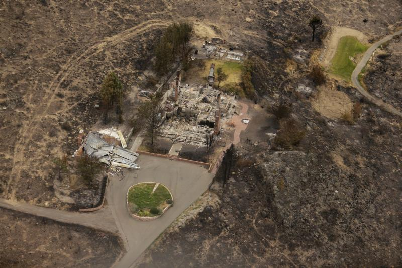 This aerial photo shows structures which were destroyed by wildfires near Pateros, Wash. on Thursday, July 24, 2014.