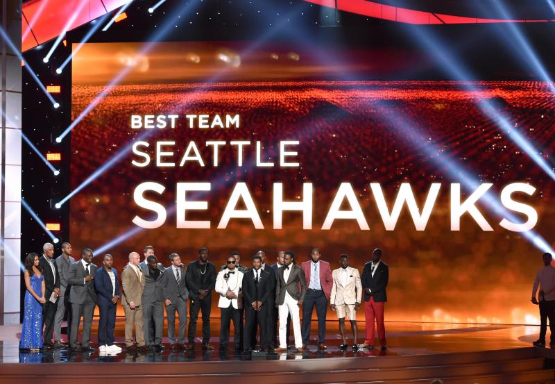 Russell Wilson and Seattle Seahawks accepts the award for best team at the ESPY Awards at the Nokia Theatre on Wednesday, July 16, 2014, in Los Angeles.