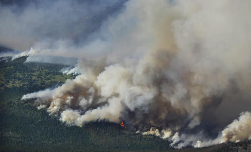 Smoke and flames are seen from the air at the Chiwaukum Creek Fire near Leavenworth, Wash., Thursday, July 17, 2014.