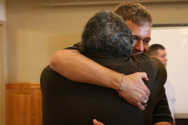 Lance Leone embraces Darryl Penn, one of his rescuers.